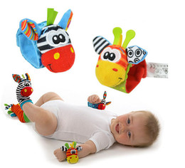 Wholesale-0-12months baby brand wrist bell infant rattle toys 4pcs Garden Bug Wrist Rattle and Foot Socks bebe boy girls Educational toys