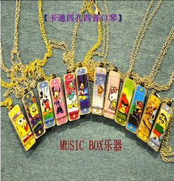 Wholesale The world s smallest harmonica necklace harmonica mini harmonica child Harmonica Cartoon design holes audio