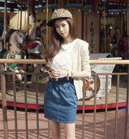 Compra Faldas de jean-Venta al por mayor de 2015 de las nuevas mujeres de la manera coreana Saia retro clásico del plisado del brote de cintura alta Denim Jean elástica mini falda de verano
