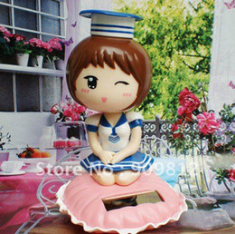 Wholesale Solar Uniform Fan Solar shaking his head doll Auto accessories Solar toys kinds of styles