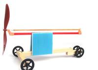 Wholesale DIY Elastic powered Propeller Car Model Intelligence Educational Toys for Children Wood Toys Boy s Gift