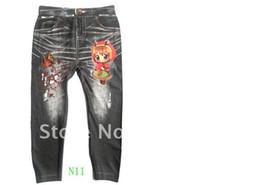 Wholesale 12pcs pantalones vaqueros de mezclilla niños de los niños pantalones vaqueros populares de los niños niños niñas polainas impresas niños fittness por mayor