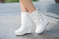 Wholesale Women s fashion rivets wedges the European version of the new ladies in tube high heeled boots Slope with motorcycle boots