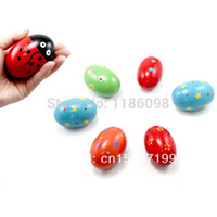 colored sand - 5pcs Sand colored wooden eggs Children s musical instruments percussion instruments toy Sand egg egg ring with Free ship Ueirt