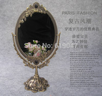 antique oval mirror - European Antique Style H Bronze Degree Rotatable Desktop Cosmetic Mirror with Flower Embossing L B012