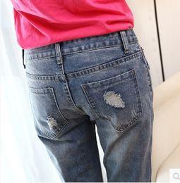 Wholesale Nueva moda popular de mujeres del otoño del verano del dril de algodón pantalones vaqueros vaqueros del agujero de la mujer destruida delgado de la calle de los pantalones de las muchachas de buena calidad