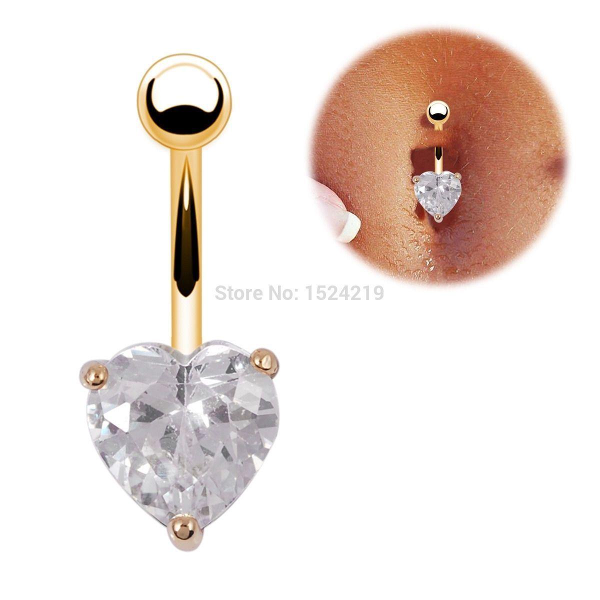 Золотой пирсинг в пупок сердечко фото 2