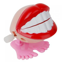 Wholesale Wind Up Smile Teeth Hopping Toy