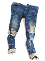 Wholesale High quality Female leopard print wearing white retro finishing hole butt lifting pencil jeans roll up hem applique DropShipping