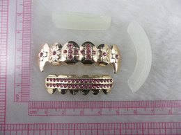 Wholesale REAL SHINY REAL GOLD PLATED PINK STONE VAMPIRE HIPHOP TEETH GRILLZ TOP amp BOTTOM GRILL SET