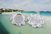 Wholesale 50Pcs quot Silver plated Cabochon Settings Pendant Trays glue on bail picture frame Flower Charms