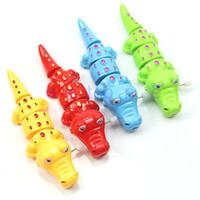 1pc niños de los niños divertidos de plástico en forma de cocodrilo Clockwork Party Up viento Juguete Nuevo