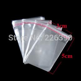 Al por mayor-200pc / lot 3 * 5cm (1.18 * 1.97inches) Pequeño blanco Claro auto-adhesivo OPP Seal Plastic Bag Joyería Packaging Poli Regalo Y994 Embalaje desde pequeñas bolsas de plástico adhesivo transparente proveedores