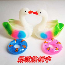 Wholesale new design squeezed bathing swan with swim ring slush molding children swimming toys for summer for