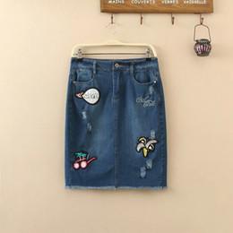 Wholesale Korean women split denim skirts embroidered patch holes in banana glasses letter denim bag hip skirt autumn
