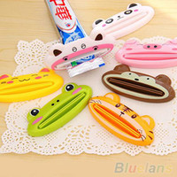 Wholesale Bathroom Home Tube Rolling Holder Squeezer Easy Cartoon Toothpaste Dispenser MO8
