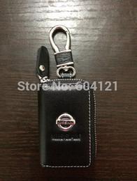 Atacado-BrandNew Nissan Car Couro Car Key Case Titular Capa Bag + Nissan Alloy Keychain Frete grátis