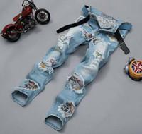 Wholesale Famous brands biker jeans for Men New designer Mens Jeans The Straight White Nightclubs Tassel Beggar Hole Skinny Jeans Plus size