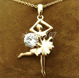 Dancer SWAROVSKI crystal stamped 18k gold necklace