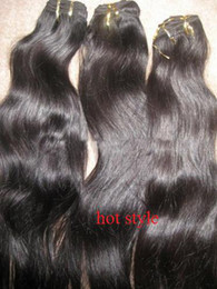 Wholesale Natural color and natural wave super quality Malaysian virgin hair machine made weft g piece