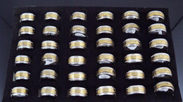 50pcs lot 10mm Width Rotate Gold Electroplated Ring Stainless Steel Rings Fashion Jewelry MIX Order