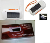 Wholesale portable new Solar mobile phone charger FM Radio solar charger LED flashlight