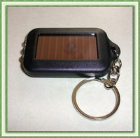 Wholesale Solar energy charging LED key chain ultra bright torch flashlight ABS resin material inside