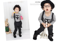 Wholesale Cotton long sleeved suit Children s cartoon two sets The long sleeved T shirt straps pants