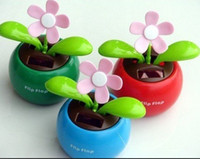 Wholesale Hot Selling Novelty Solar Powered Flip Flap Flower Cool Car Dancing Toys Car Decorations Solar toys