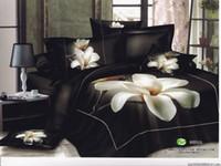 al por mayor consolador de la reina negro-El edredón negro del consolador del lecho de la reina del patrón de las flores blancas 2015 cubre los sistemas 4pc