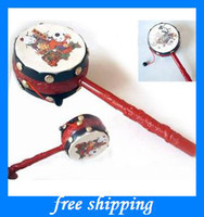Wholesale china Classic rattles baby toys hand shaking drum pull rattle auspicious baby gifts