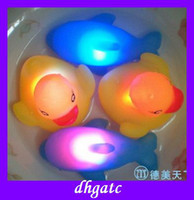 Unisex 5-7 Years Plastic LED rubber ducks toys swimming colorful dolphin floating baby bath toys hot gifts free shipping