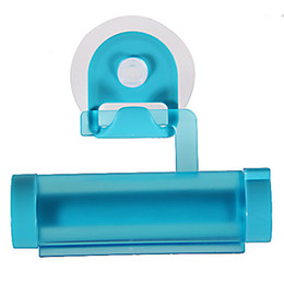 Wholesale Practical Plastic Roller Toothpaste Squeezer Dispenser with Sucker Holder for Home and Travel Blue