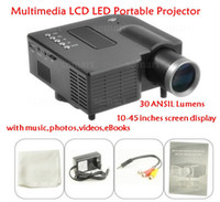 Wholesale 30 ANSIL Lumens Multimedia LED LCD Portable Projector with music photos videos eBooks
