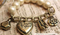 Women's avatar bow - Charm Vintage Avatar Love Heart and Clock Pearl Bracelet with Bow