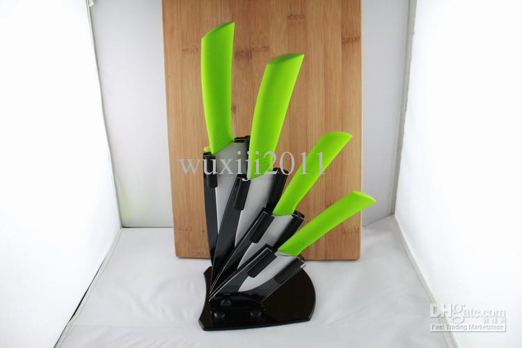 kitchen knives, green handle white blade with acrylic knife block
