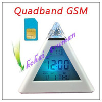 Wholesale Quad band GSM SIM Card Ear Bug colorful Desk Alarm Clock Voice Detection