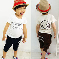 Wholesale Children s clothing new smiley boys short sleeved suit children s leisure suits