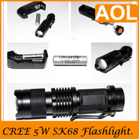 Wholesale LED Torch SK68 Uniquefire mini Flashlight Torch adjust light LC14500 battery AC charger