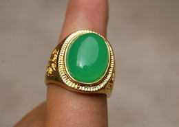 Copper alloy inlaid with jade rings. Green jade ring surface. The inside diameter of about 18mm.