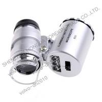 Mini 60X Joyero Lupa Lupa Microscopio UV Detector de moneda con Luz LED