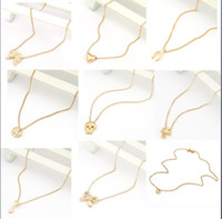 Wholesale mixed gold necklaces wishing collarbone chain homocentric bow heart anti war cross wing skeleton key