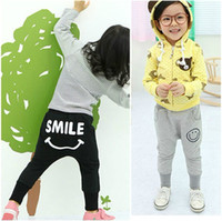 Wholesale Children Casual trousers autumn new boys and girls cute Classic smiley style pants dandys
