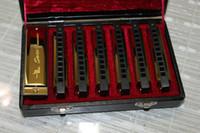 Wholesale Newest hole tone senior blues golden tune set packing square harmonica large spec free case