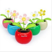 Wholesale Novelty Flip Flap Solar Powered Flower Flowerpot Swing Solar Dancing Toys Car decor sunflower
