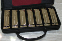 Wholesale Best Selling hole tone tune set packing harmonica gift bag
