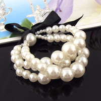 Wholesale charm pearl bowknot bracelets three layer pearl stretch bracelet set BR