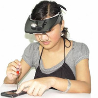 Wholesale new Adjustable head visor with magnifying glasses and white head light