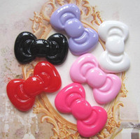 Wholesale very popular and kawaii flat back resin bow for DIY decoration for colors sm