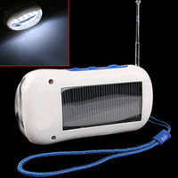 Wholesale Solar FM Radio Torch Flashlight with Phone Charger Versatile Super Bright Adapters for Travel